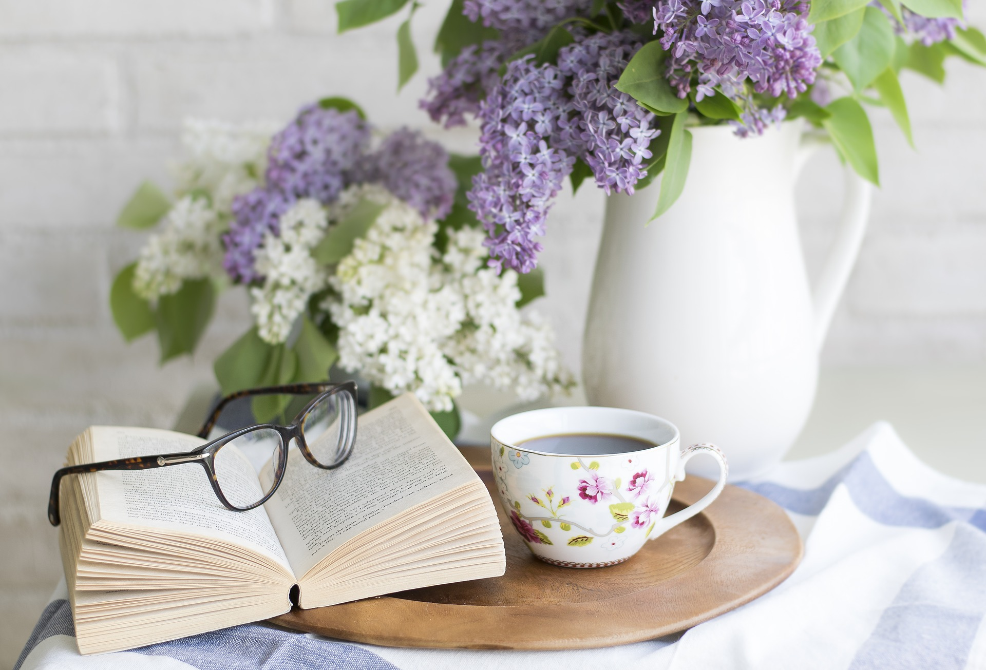 Chrysanthemums, a Cup of Tea, an Open Book and Glasses